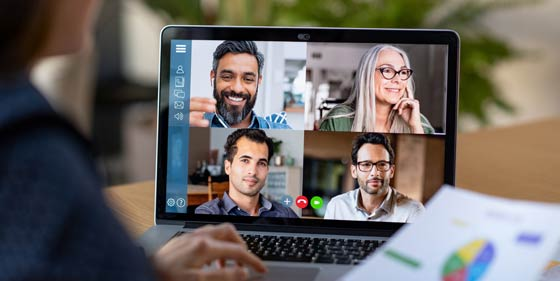 four-employees-video-conferencing
